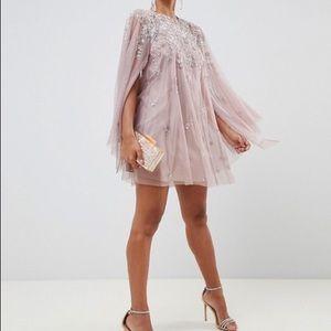 ASOS DESIGN mini dress w/ heavily embellished cape